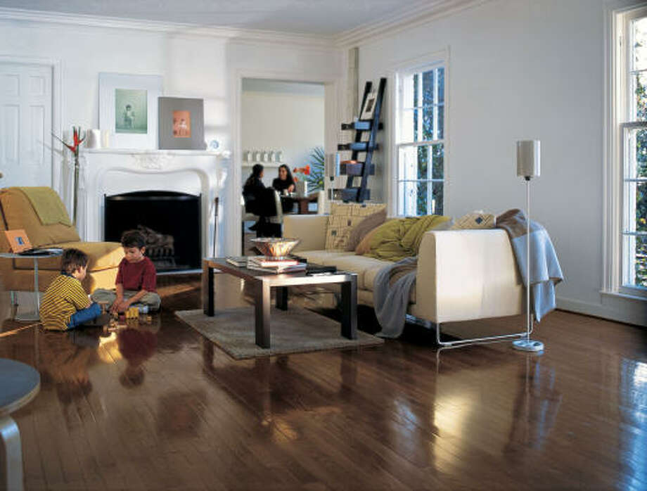 new look: A new floor, such as this dark hardwood, provides a soothing accent that brings a new dimension to any room.