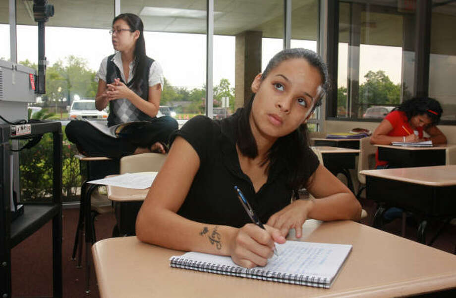 Jocelyn Cruz, 19, a student at The High School for Business and Economic Success, takes a TAKS history review class. Photo: Gary Fountain, Chronicle