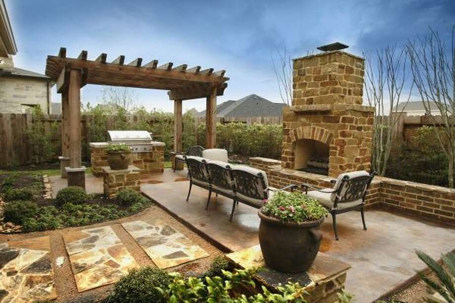 Outdoor kitchens provide a welcome backyard retreat and can include fireplaces, seating areas and grills, etc.