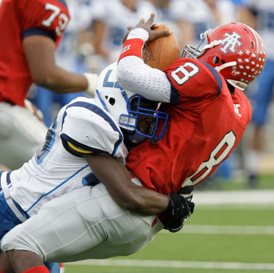 Brazoswood's Clarence Green sacks Alief Taylor quarterback Jordon Are on Friday at Tully Stadium. Photo: Melissa Phillip, Chronicle