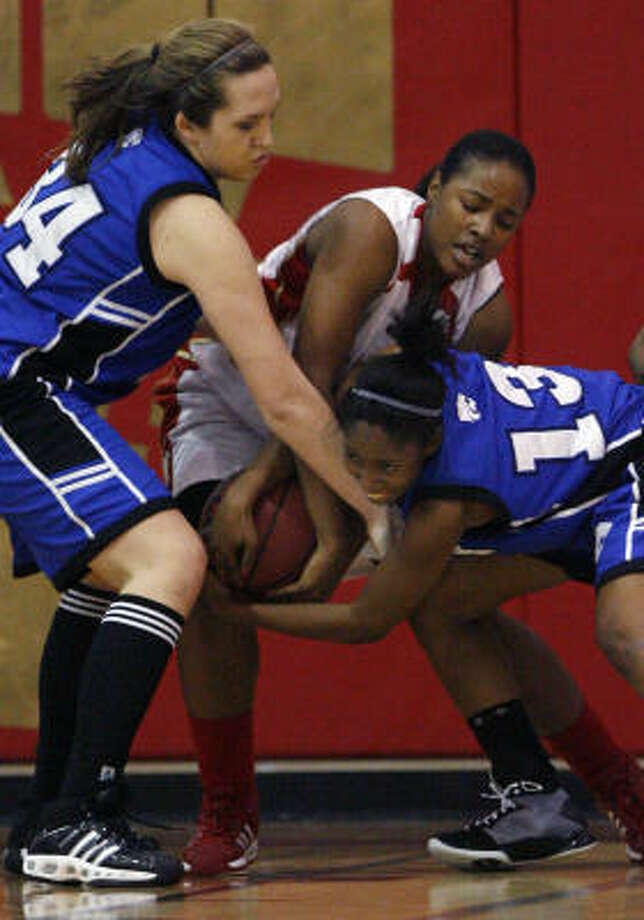 Cy-Creek's Sara Adkison (34) and Dawn Kiel (13) battle for a loose ball with Cy-Woods' Bre Douglas (55) during the first half. Photo: Brett Coomer, Chronicle