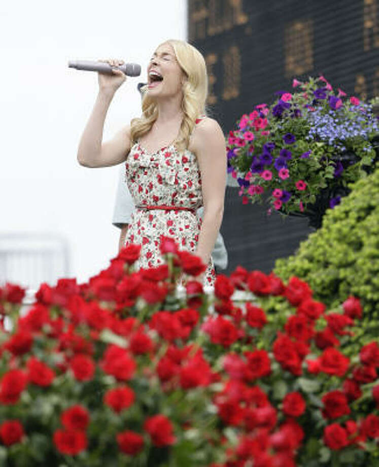 Lee Ann Rimes belts out the national anthem before the 135th running of the Kentucky Derby on Saturday. Photo: Mark Cornelison, MCT