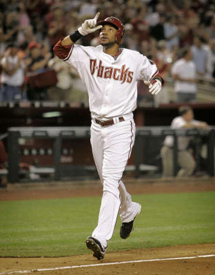 Arizona's Chris Young celebrates his solo home run against the Houston Astros. Photo: Matt York, AP