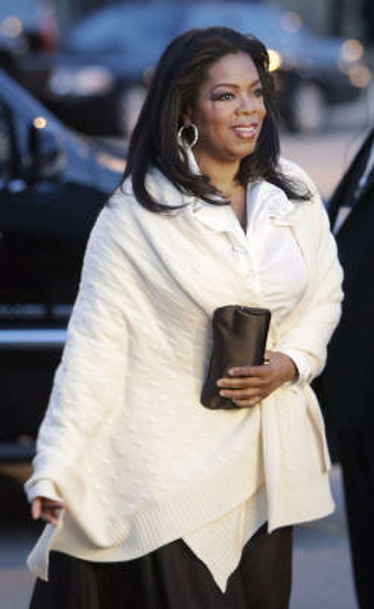 Talk show host Oprah Winfrey arrives at the Art Institute of Chicago for a dinner in honor of the International Olympic Committee's Evaluation Committee in Chicago, Monday, April 6, 2009.