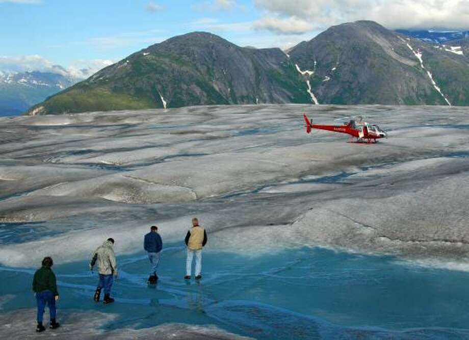 Cruise ship passengers take a shore excursion at Alaska's Hole-in-the-Wall Glacier in July 2007. The state's beauty has made it a popular destination for vacationers. Photo: ANDY NEWMAN, ASSOCIATED PRESS