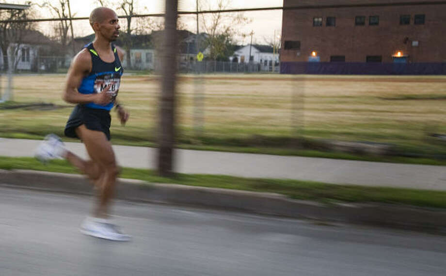 Meb Keflezighi, a former Olympic silver medalist in the marathon, finished the Aramco Houston Half Marathon in 1:01:25, 10 seconds in front of second-place Dathan Ritzenheim. Photo: Smiley N. Pool, Chronicle