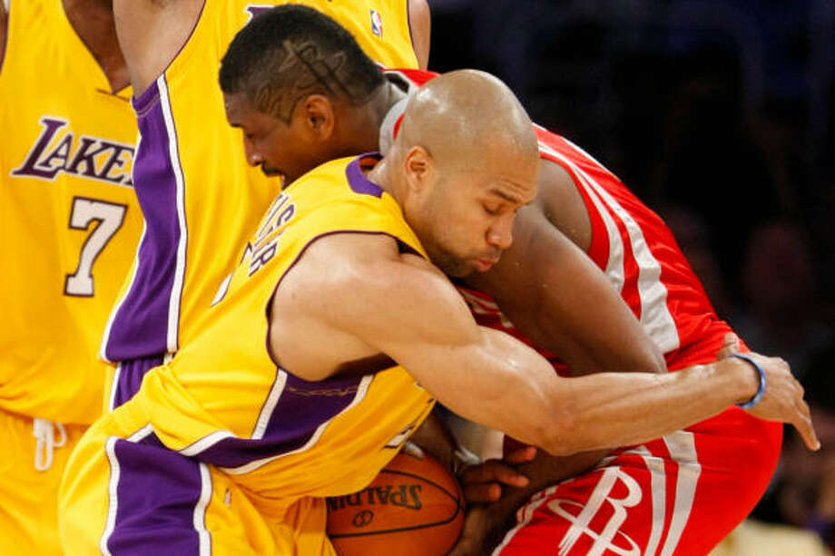 Ron Artest, right, collides with Lakers guard Derek Fisher during a hotly-contested second half. Photo: Nick De La Torre, Chronicle