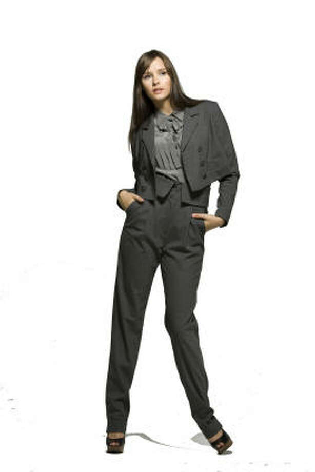 Kate Baxter of the Neal Hamil Agency wears items from the Caycee Black fall-winter 2009 collection, including the wool gentlemen's jacket in charcoal, $575; skyscraper pants in steel wool, $525; and a silk tuxedo blouse in charcoal, $388. All are available at Tootsies. Photo: Nick De La Torre, Chronicle