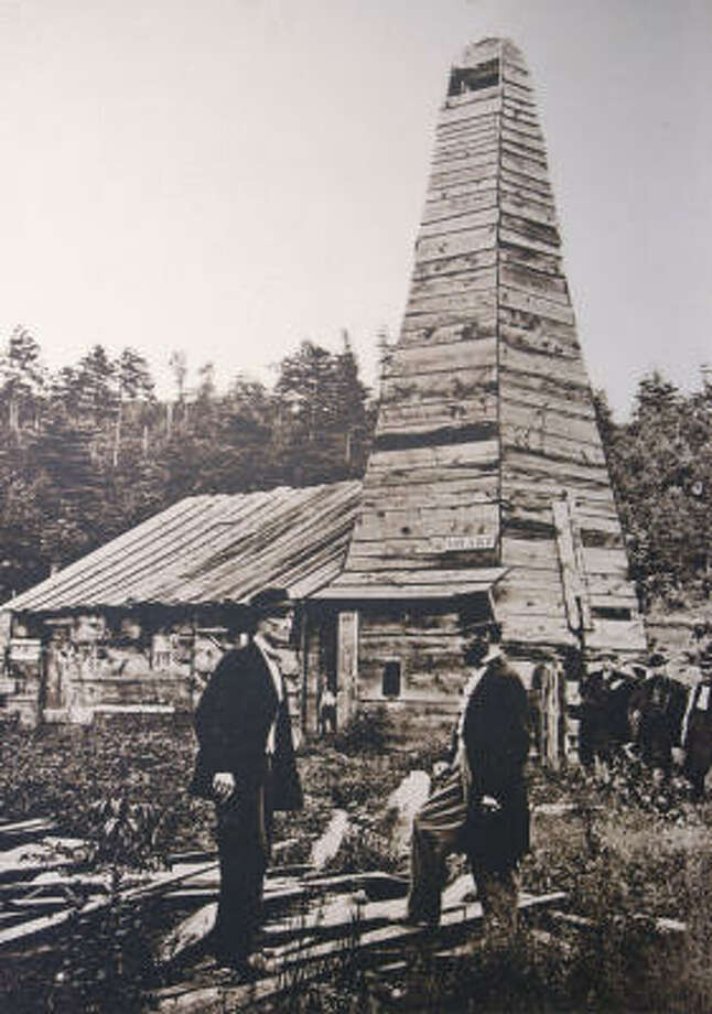 """""""Colonel"""" Edwin Drake, right, discovered oil in Titusville, Pa., in 1859. By 1900, derricks covered the landscape. Photo: Drake Well Museum And Park"""