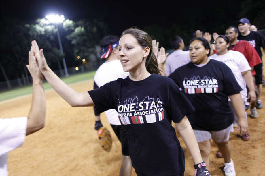 Air Force veteran Shannon Wilson and fellow Lone Star Veterans Association members have their own softball team. Photo: Mayra Beltran, Chronicle