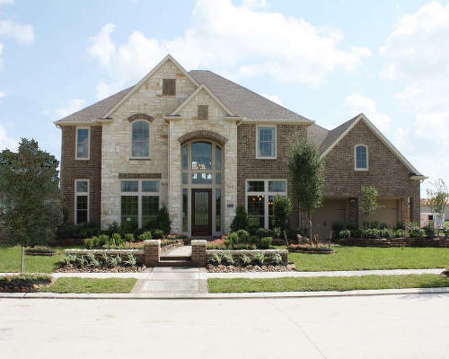 12522 Brook Cove Drive: Perry Homes has opened two new models in Bridgeland's new model home park. A grand opening for the park is slated for spring 2010. Pictured is Perry's model home at 12522 Brook Cove Drive.