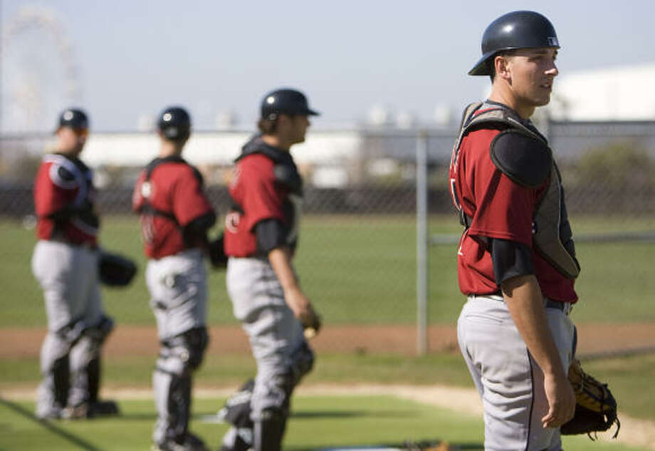 Jason Castro, right, the Astros' top pick in 2008, is on track to become the team's starting catcher only two years after being drafted. Photo: James Nielsen, Chronicle