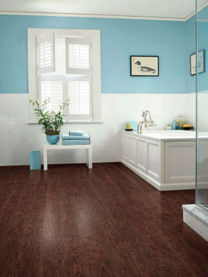 PERFECT FOR BATH: The wood looks faux, and the practicality is real. Laminate flooring is a good choice for a bath that sees a lot of splashing.