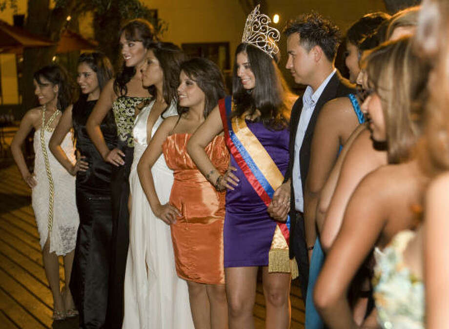 Contestants show off their gowns and best pageant poses last week after a walkthrough for this weekend's Miss Colombian Independence Contest. Photo: Brett Coomer, Chronicle
