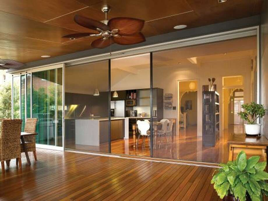 "The Eco-Screen is a retractable screen and blind system for windows and doors that integrates indoor and outdoor living and even doubles as a projection ""big screen."" Photo: Bruce Peebles, AP"