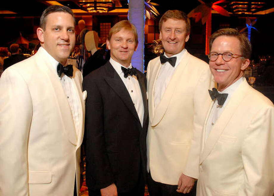 Joining the fundraising effort on behalf of the symphony were Houston Symphony CEO Matthew VanBesien, from left, co-chairs Andrew McFarland and Tom Glanville and gala chair Erik Littlejohn. Some of the guests wore white dinner jackets for the Casablanca-themed evening. Photo: Dave Rossman, For The Chronicle
