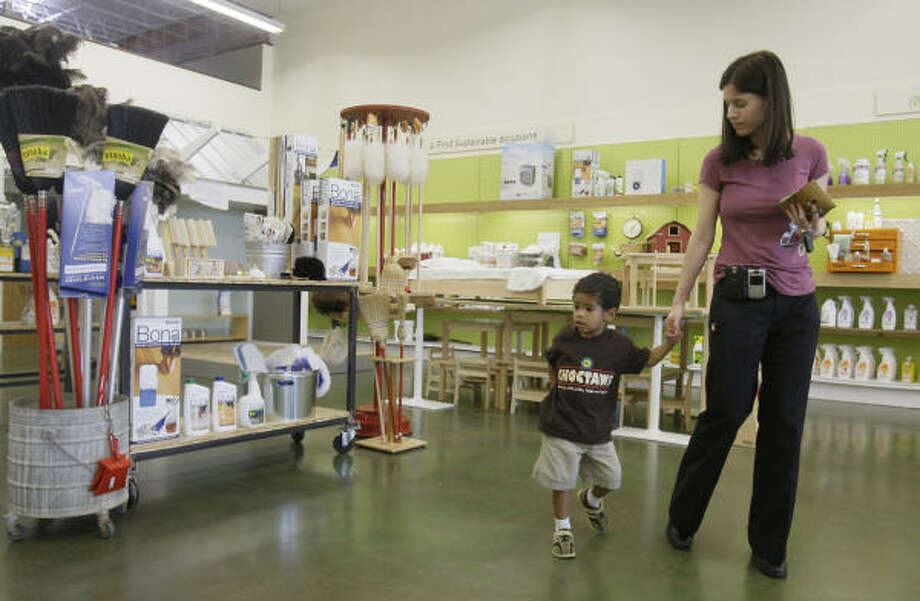 Ashleigh Guadagnolo and her son, Griffin Raphael, 3, shop at New Living, the Green Building + Home Store,  6111 Kirby. Photo: Melissa Phillip, Chronicle