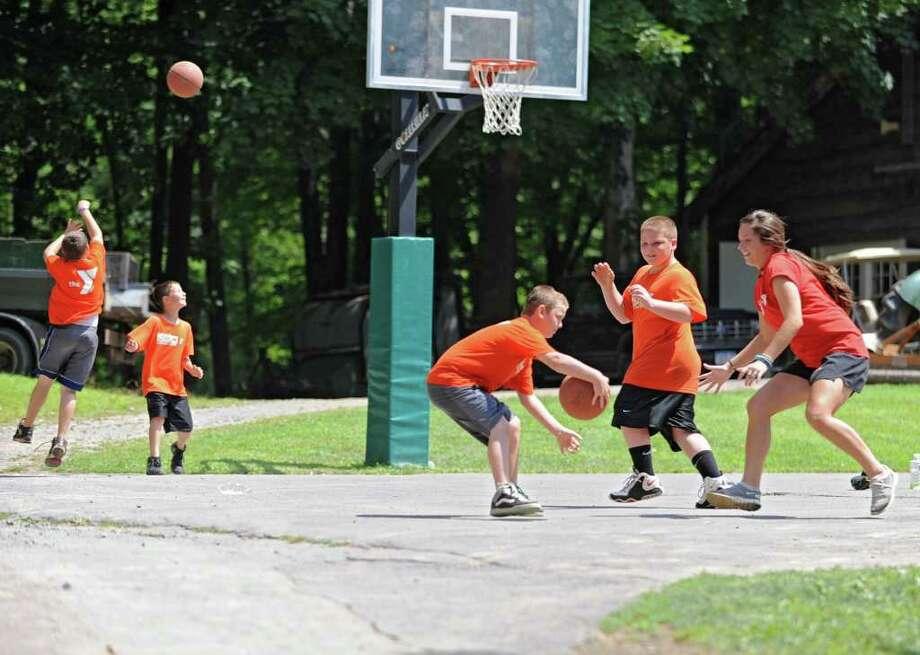 Kids play basketball during the YMCA Strong Kids Day held at YMCA Camp Nassau in Guilderland, N.Y. on Friday, Aug. 5, 2011.  (Lori Van Buren / Times Union) Photo: Lori Van Buren