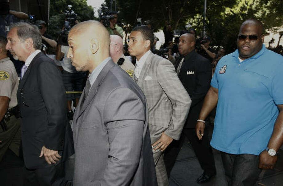 Chris Brown, center, pleaded guilty to one count of felony assault on pop star Rihanna. Photo: Matt Sayles, Associated Press