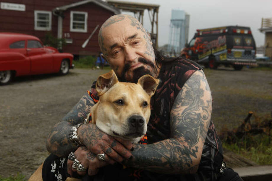 Rescue Ink member Batso and his dog Inka. Photo: Shea Roggio, National Geographic Channel /She