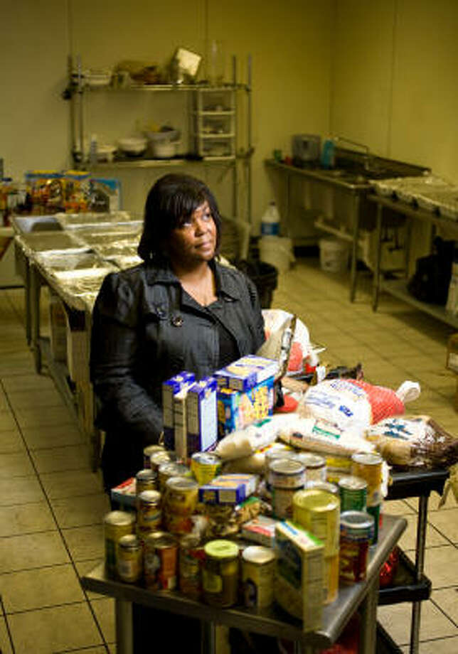 Stephanie Lewis, project director of the City Wide Club of America, had said the group had only 300 of the 1,000 turkeys it needs for the Thanksgiving feast at the George R. Brown Convention Center. Photo: Nick De La Torre, Chronicle