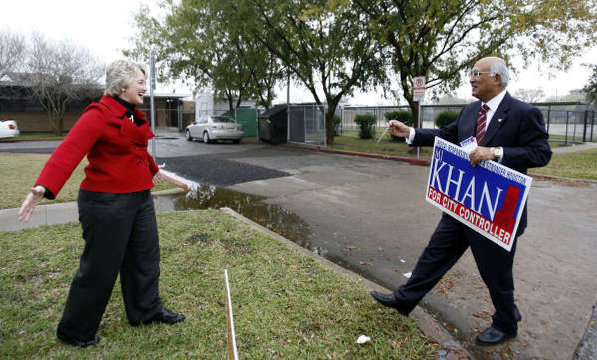 Annise Parker shares a light moment with candidate M.J. Khan, who ran to replace her as city controller, outside Pleasantville Elementary School on Saturday.