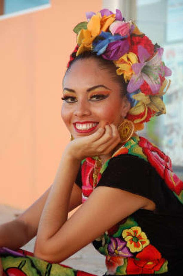 A Mayan dancer awaits showtime on the beach at Fiesta Americana. Photo: MELISSA WARD AGUILAR, Chronicle