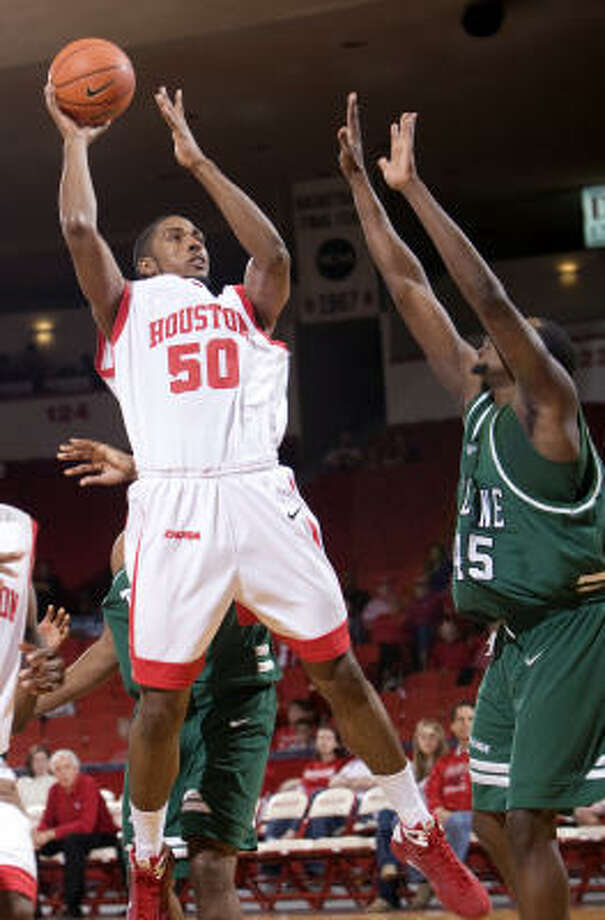 UH's Marcus Cousin faces a tall task tonight with Tulsa 7-footer Jerome Jordan. Photo: Bob Levey, For The Chronicle