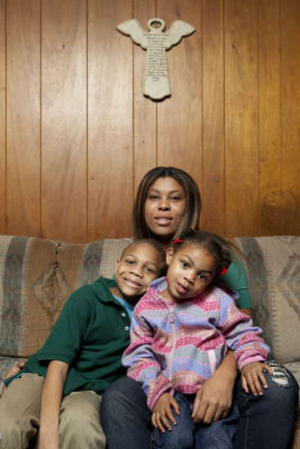 Mia Blaze and her two children, Sariyah White, 2, and Tyran Blaze, 6, live with friends in a two-bedroom house. She has re-enlisted in the Army Reserves and is attending college. Photo: Nathan Lindstrom, For The Chronicle
