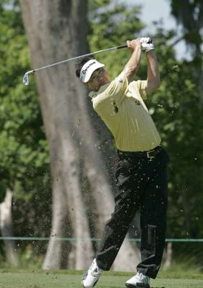 Charlie Wi tees off on the eighth hole during the first round of the Zurich Classic. Photo: Bill Haber, AP