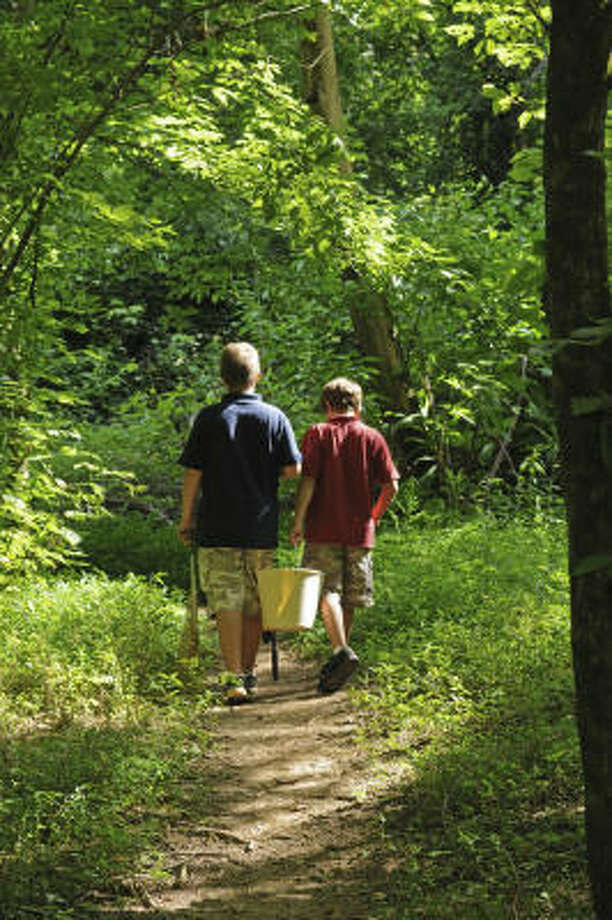 A RELAXING TIME: Hiking and fishing are popular pastimes along Mill Creek.