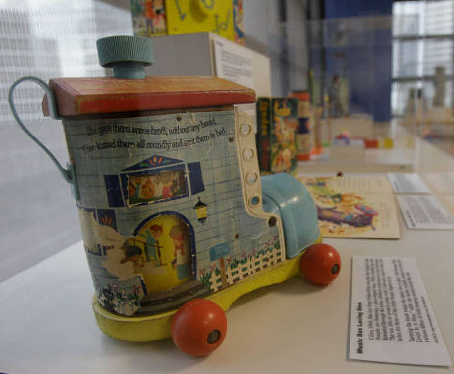 A Fisher-Price Little People set, circa 1964, is among many of Brucks Hall's toys from the Houston Toy Museum on display at Texas Children's Hospital. Hall is selling his rare collection. Photo: Melissa Phillip, Chronicle