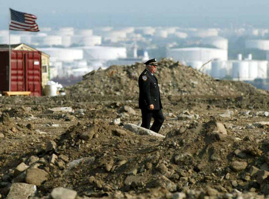 Chief of Detectives Bill Allee walks amid the sifted debris at the Fresh Kills landfill in Staten Island, N.Y., in 2002. An appellate court has affirmed that families' religious rights were not violated regarding the handling of the debris. Photo: JEFF ZELEVANSKY, ASSOCIATED PRESS FILE