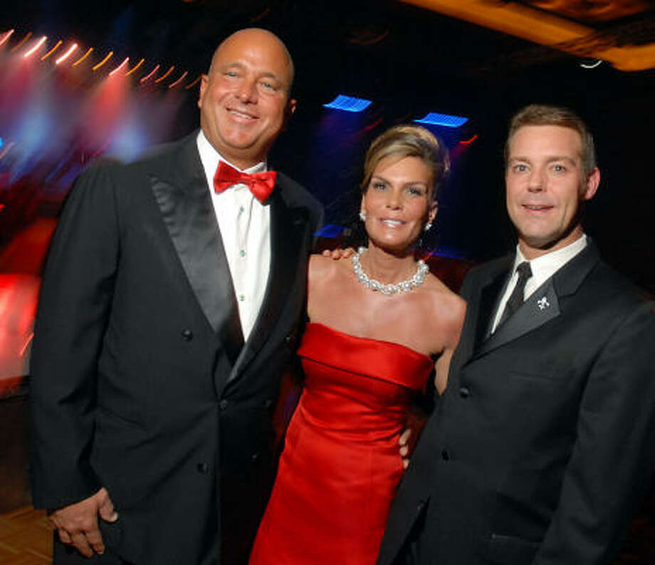 Mark and Debra Grierson with Paul-David Van Atta chaired the Legacy Community Health Services Cabaret for a Cure at the Hilton Americas Houston on Friday. Photo: Dave Rossman, For The Chronicle