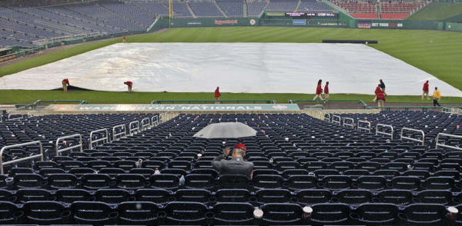 The rain got much harder in the 11th inning and forced the grounds crew to unveil the tarp for good. Photo: Pablo Martinez Monsivais, AP