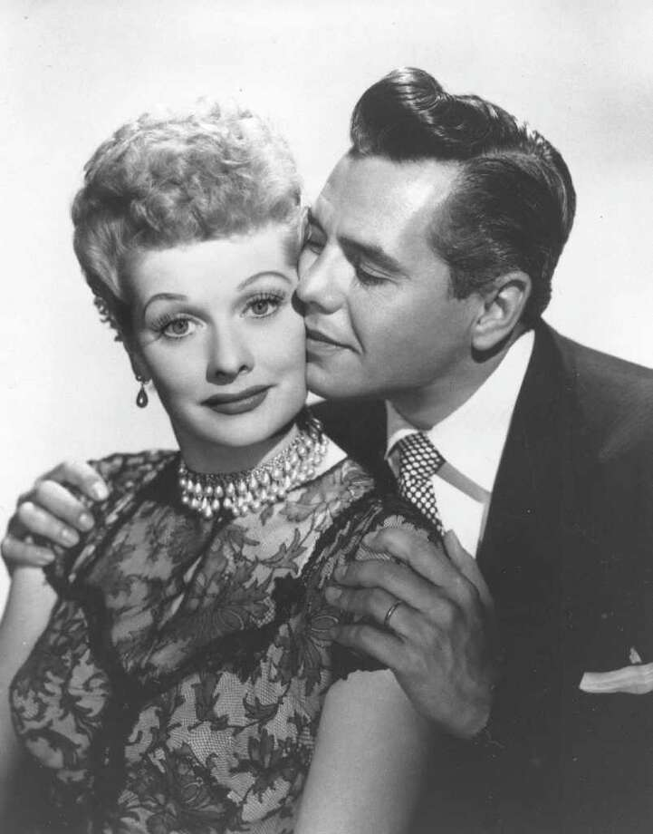 """Comedian-actress Lucille Ball and her husband, musician-actor Desi Arnaz  from the comedy series, """"I Love Lucy,"""" are shown. Ball, who died on April 26, 1989, would have celebrated her 100th birthday on Saturday, Aug. 6, 2011. (AP Photo/file) Photo: Associated Press / AP"""