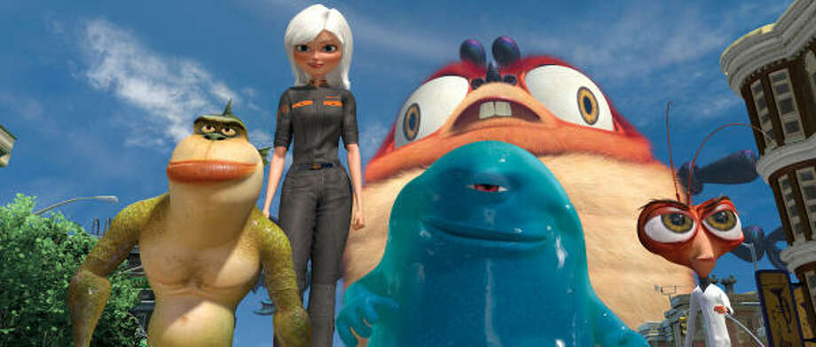 The Missing Link (Will Arnett, from left), Ginormica (Reese Witherspoon), B.O.B. (Seth Rogen), Insectosaurus and Dr. Cockroach, Ph.D. (Hugh Laurie) defend the Earth against an alien invasion in Monsters vs. Aliens. Photo: MCT