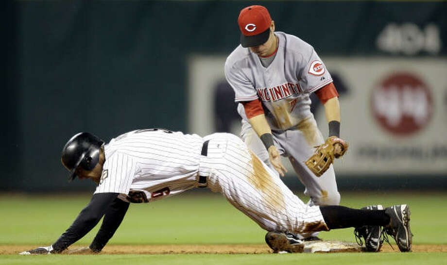 Hunter Pence trips over Reds shortstop Paul Janish after being tagged out trying to stretch a single into a double. Photo: David J. Phillip, AP