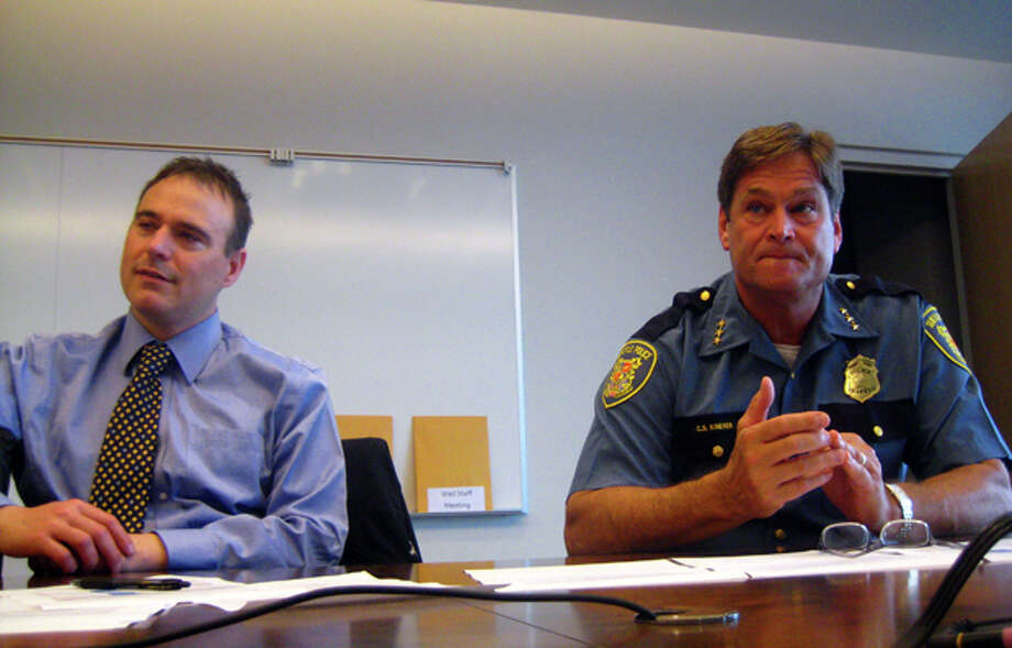 Deputy Chief Clark Kimerer, right, and Sgt. Sean Whitcomb discuss Seattle Police statistics as a result of the Neighborhood Policing Plan that was adopted in 2007. (Casey McNerthney/seattlepi.com)