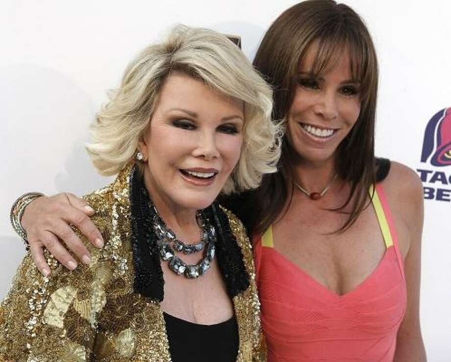 Joan Rivers wasn't laughing when an interviewer made a quip at her 41-year-old TV host daughter Melissa's expense. Photo: DAN STEINBERG, Associated Press