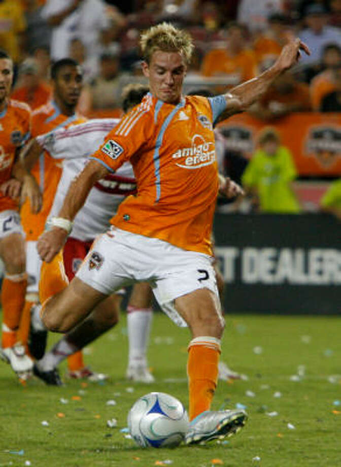 Midfielder Stuart Holden and the Dynamo will try to take down Pachuca in tonight's matchup. Photo: Julio Cortez, Chronicle