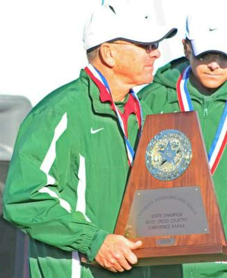 The Woodlands track and cross country coach Dan Green, holding the 2008 UIL state cross country trophy, has won 15 cross-country championships. He's a two-time national high school cross-country coach of the year Photo: Gerald James, Houston Chronicle