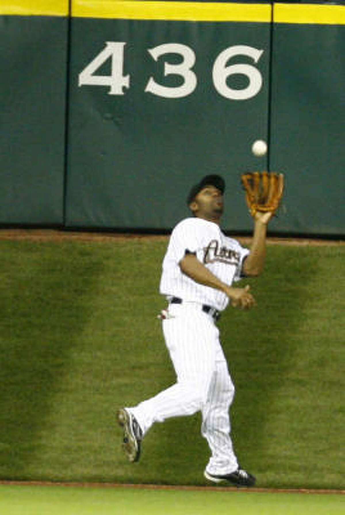 Astros center fielder Michael Bourn routinely made difficult catches on Tal's Hill at Minute Maid Park this season.