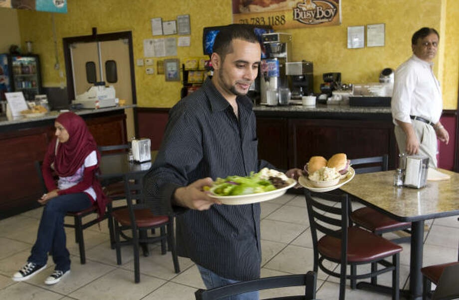 Salem Salem serves a salad and sandwich that uses halal meat at his restaurant BusyBoy Mediterranean Grill and Cafe in Houston. Many halal restaurants in Houston are serving traditional and non-traditional South Asian and Middle Eastern foods. Photo: BRETT COOMER :, CHRONICLE