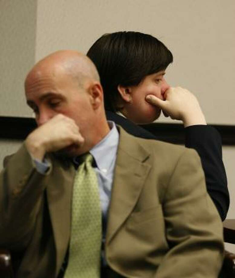 Royce Clyde Zeigler II, right, and Neal Davis III, one of his attorneys, wait Thursday for the second day of his trial to begin. Photo: Jennifer Reynolds, Galveston Daily News