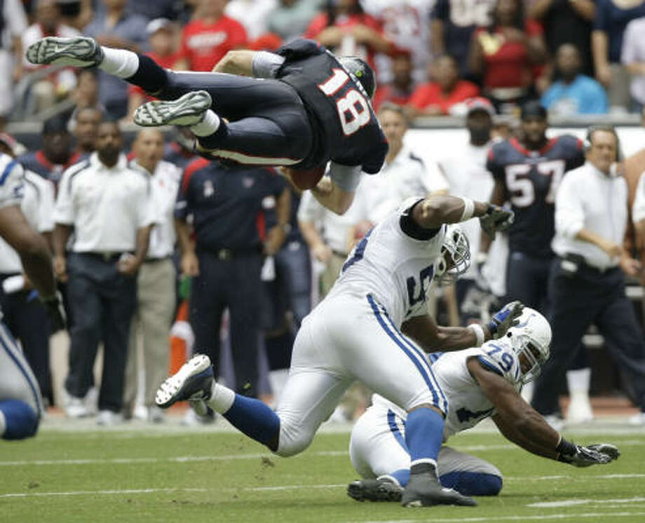 Houston Texans quarterback Sage Rosenfels (18) is hit by Indianapolis Colts defensive end Dwight Freeney (93) and Raheem Brock (79), forcing a fumble that resulted in a Gary Brackett return for a touchdown at Reliant Stadium. Photo: Brett Coomer, Houston Chronicle