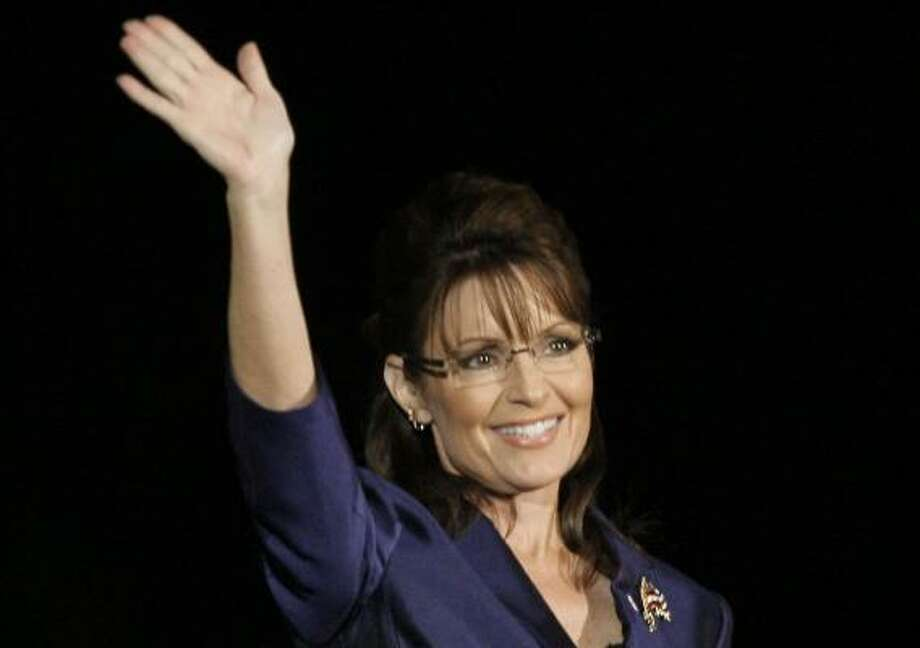 Vice presidential candidate Sarah Palin acknowledges the crowd on Election Night in Phoenix. Photo: Elise Amendola, AP