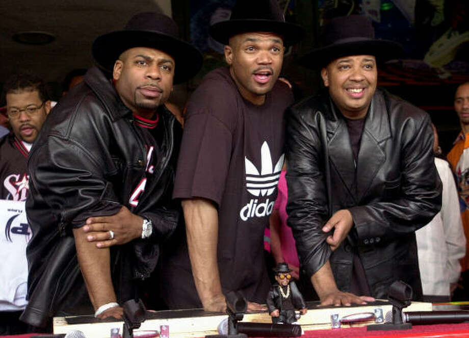 "RUN-DMC had hits with songs like ""My Adiddas"" and ""It's Tricky,"" but had their greatest success when they remade Aerosmith's ""Walk This Way"" with the rock act for a groundbreaking collaboration. Photo: KRISTA NILES, Associated Press"