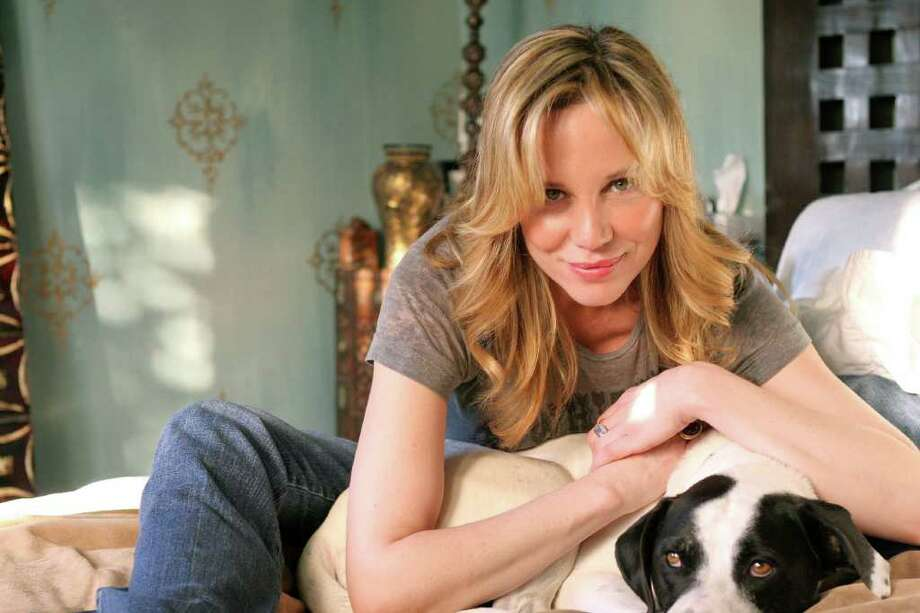 Kari Whitman, pictured here with Lucy, is a Los Angeles-based designer and founder of the non-profit dog rescue Ace of Hearts (www.aceofheartsdogs.com). Whitman often incorporates doggie design into her projects. Photo: Melanie Warner Spencer