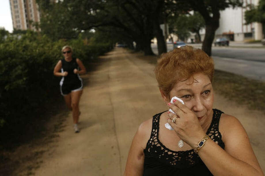 Guadalupe Acosta was wounded May 5 on Rice University's jogging path when a Metro officer fatally shot a knife-wielding man. The bullet entered her rear shoulder and came out through her biceps. The scar is visible on her right upper arm. Photo: Mayra Beltran, Chronicle
